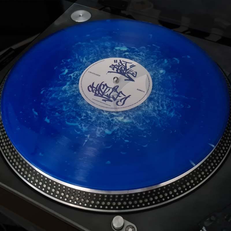 HJ002 Repress - DJ Crystl - Blue Smoke Vinyl On Turntable